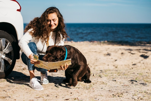 Young woman with her dog at the beach