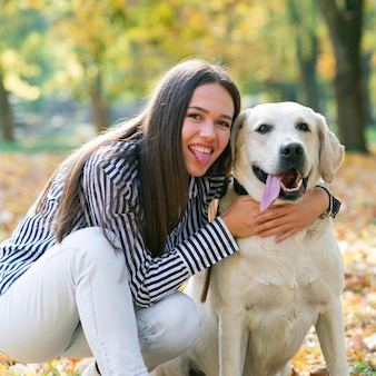 Young woman with her lovely dog