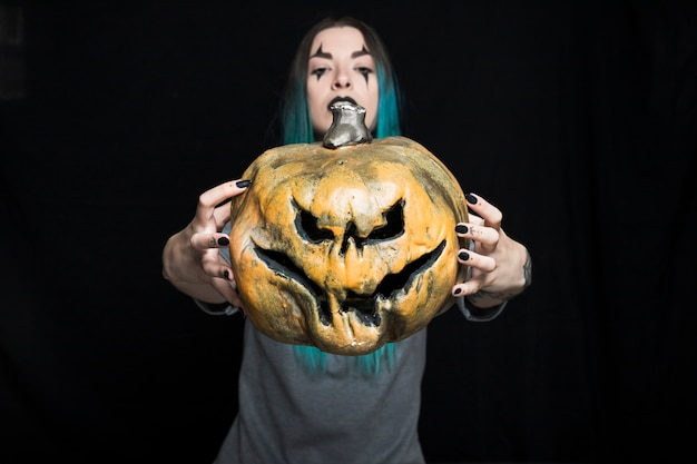 Young woman with jack-o-lantern