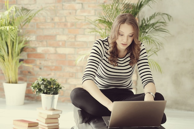 Young woman with laptop pc computer