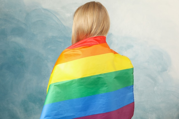 Young woman with lgbt flag