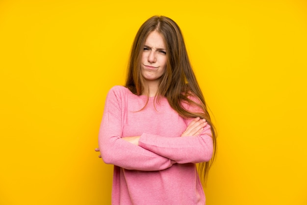 Young woman with long hair feeling upset
