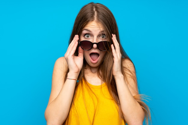 Young woman with long hair with glasses and surprised