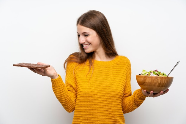 Young woman with long hair with salad