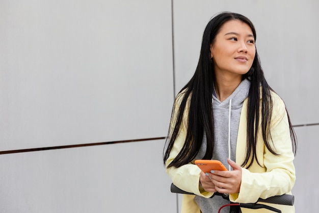 Young woman with mobile outdoor