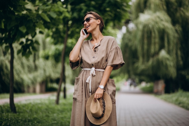 Young woman with mobile phone in park