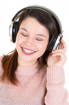 Young woman with music headphones eyes closed look happy smile