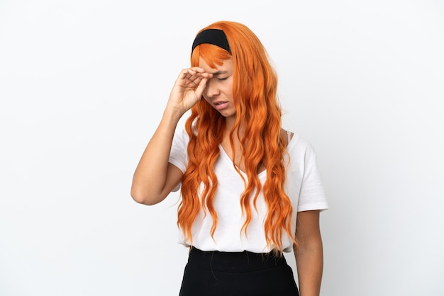 Young woman with orange hair isolated on white background with tired and sick expression