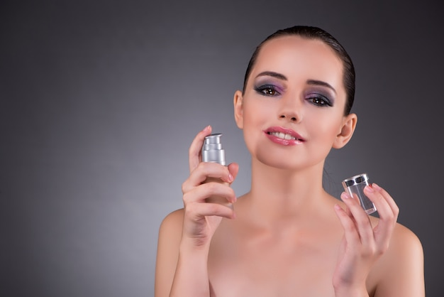 Young woman with perfume in beauty concept