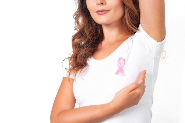 Young woman with a pink ribbon supporting breast cancer awareness