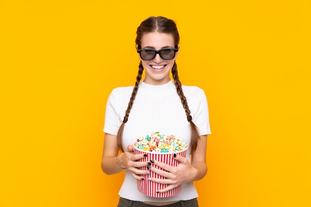 Young woman with popcorns