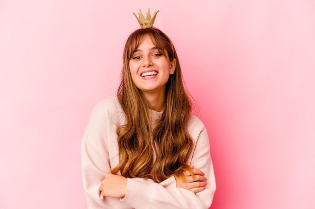 Young woman with princess crown isolated laughing and having fun
