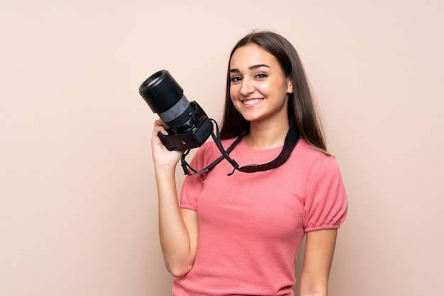Young woman with a professional camera