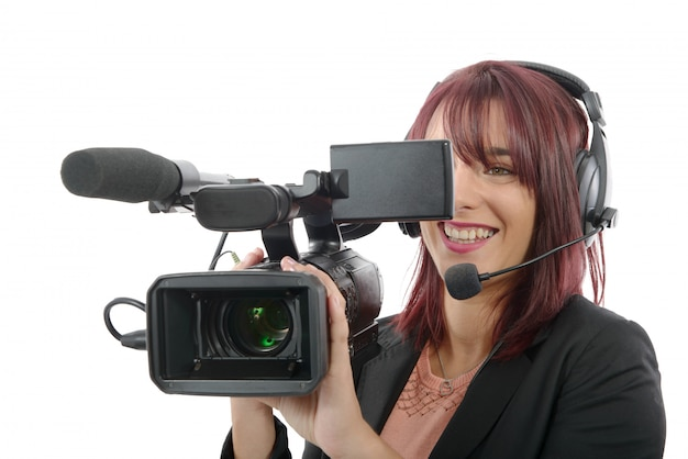 Young woman with a professional video camera