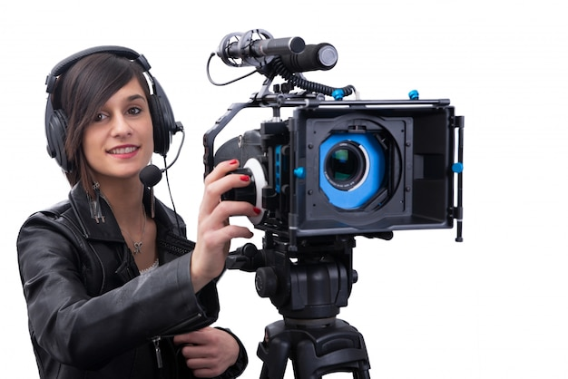 Young woman with professional video camera