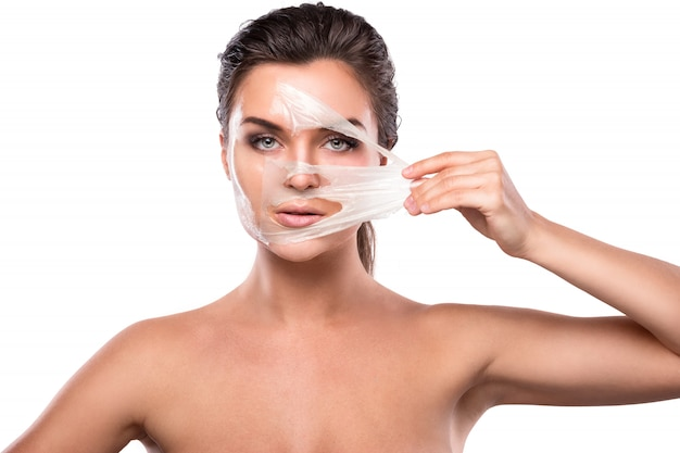 Young woman with purifying mask on her face