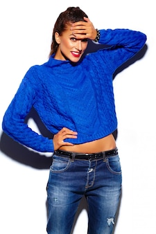 Young woman with red lips wearing a blue sweater