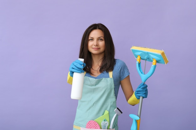 Young woman with rubber gloves, ready to clean