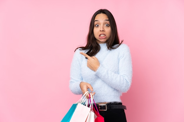 Young woman with shopping bag isolated