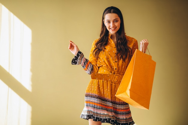 Young woman with shopping bags in a beautiful dress