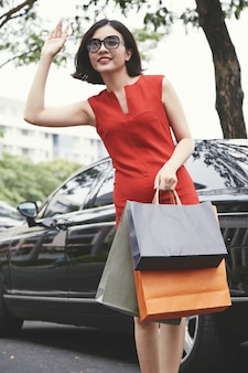 Young woman with shopping-bags
