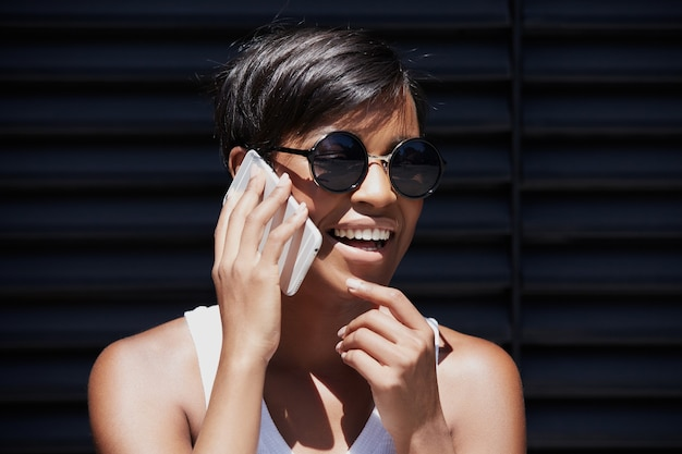 Young woman with short hair talking on the phone