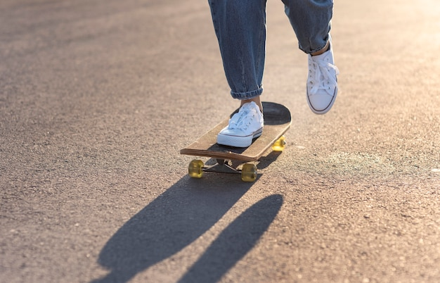 Young woman with skateboard close up