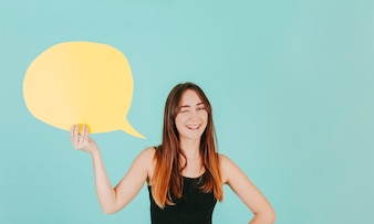 Young woman with speech bubble winking