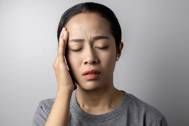 Young woman with of stress and headaches.