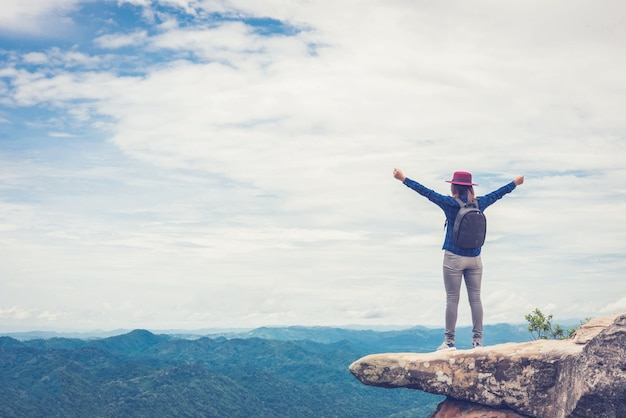 Young woman with the success in the highest point - success concept