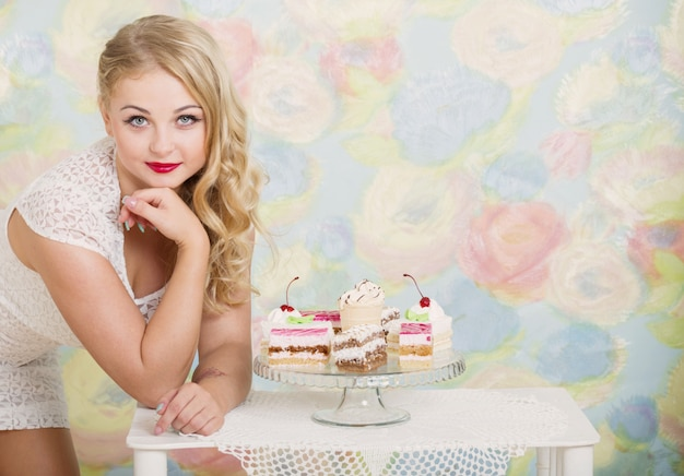 Young woman with sweet cake