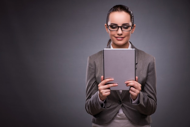 Young woman with tablet in business concept