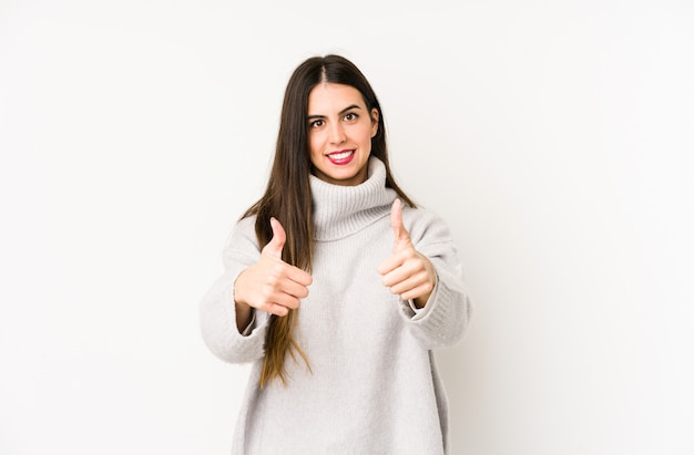 Young woman with thumbs ups, cheers about something
