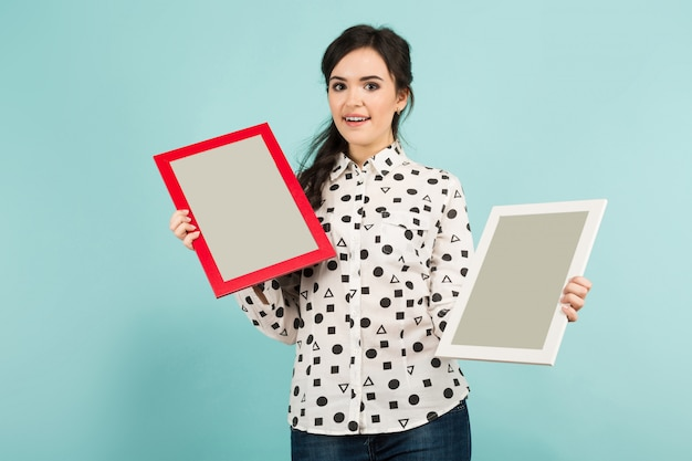 Young woman with two blank frames