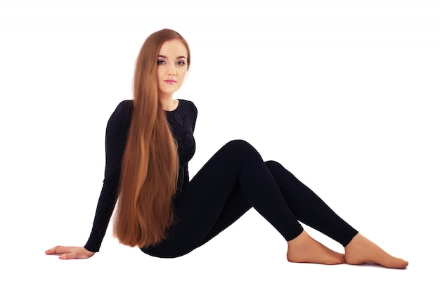 A young woman with very long straight hair.