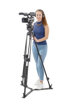 Young woman with a video camera on white