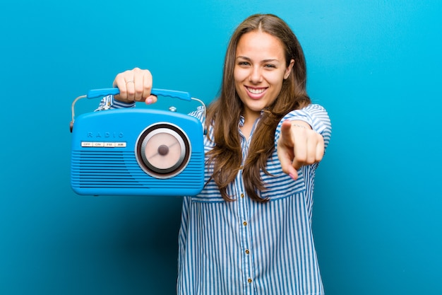 Young woman with a vintage radio  blue