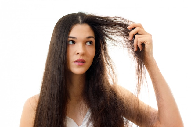 Young woman with well-groomed combed and problem unkempt hair