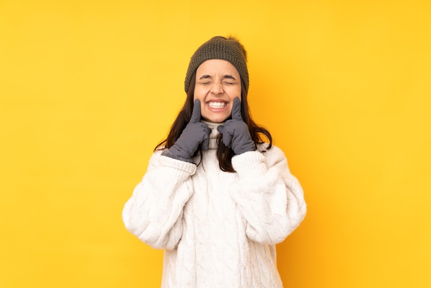 Young woman with winter hat isolated
