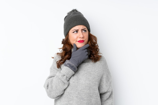 Young woman with winter hat thinking an idea