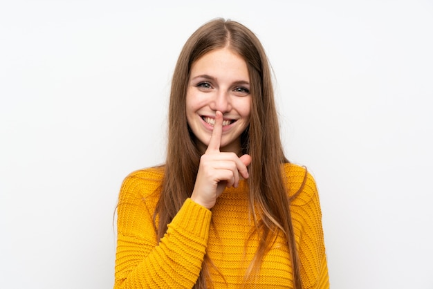 Young woman with yellow doing silence gesture