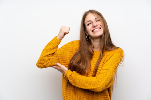 Young woman with yellow over isolated white wall making strong gesture