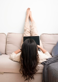Young woman working as freelancer from couch