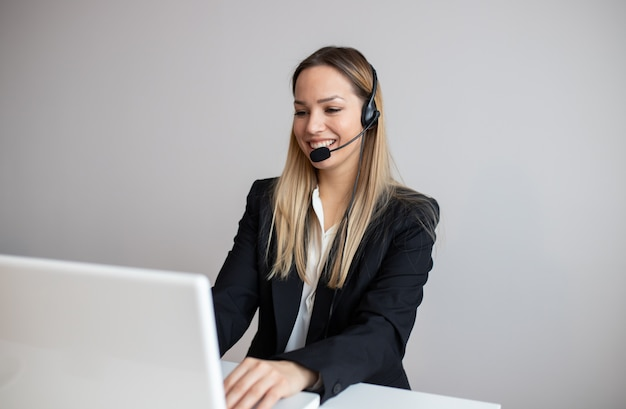 Young woman working in call center