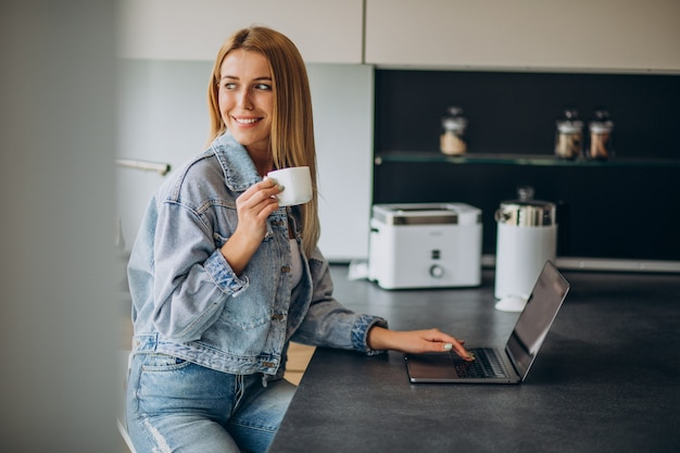 Young woman working on computer from home
