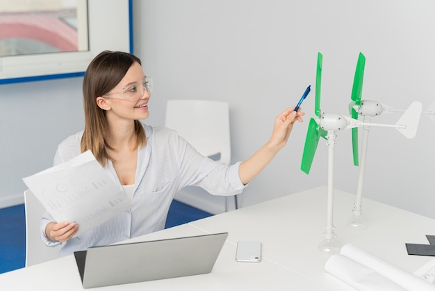 Young woman working on an energy power innovation