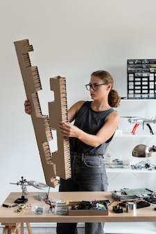 Young woman working in her workshop for a creative invention