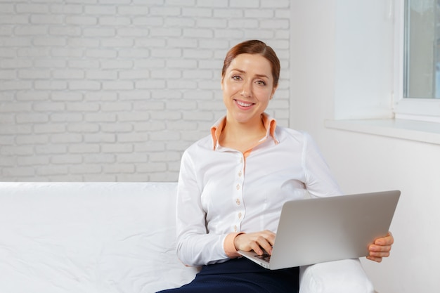 Young woman working at laptop in the office