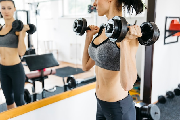 Young woman working out in the gym
