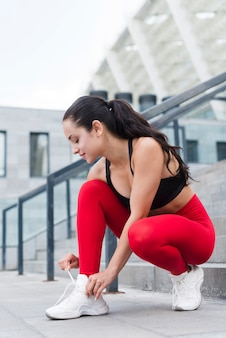 Young woman working out at the street